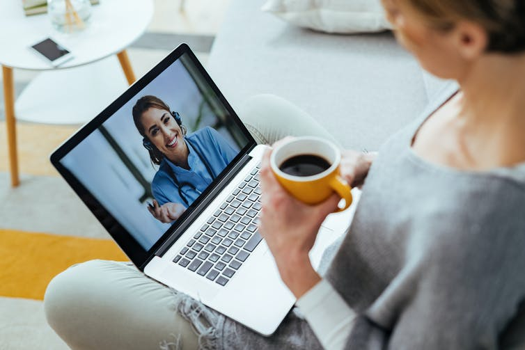 A woman video chatting with a health professional.