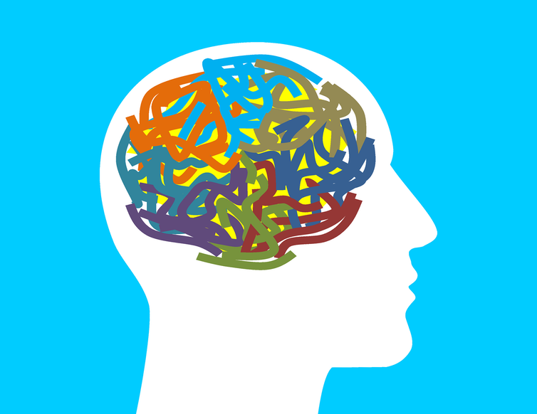 Silhouette of head with coloured scribbles for brain