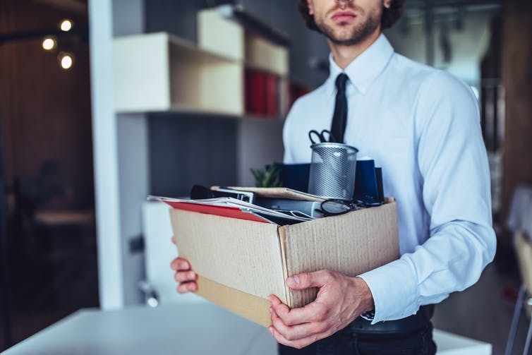 Man carrying box of office supplies