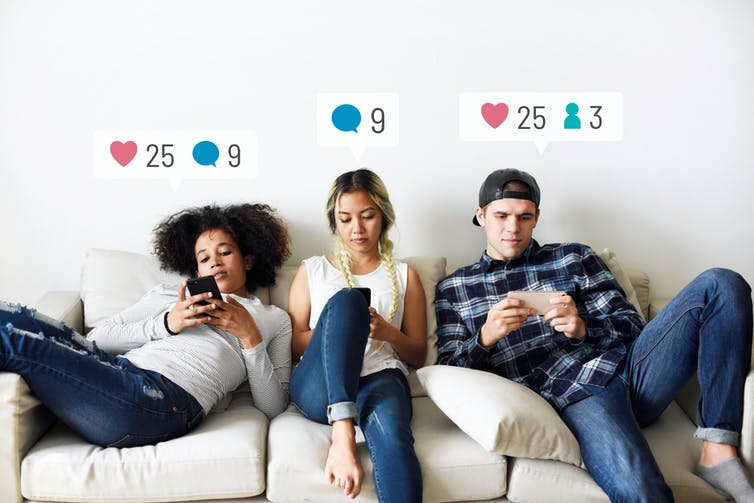 Three young people sitting on a sofa using phones with social media notification graphics over their heads