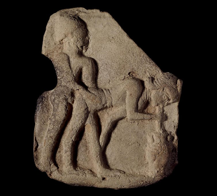 Standing man penetrating a standing woman who is bent over sipping beer out of an urn with a straw