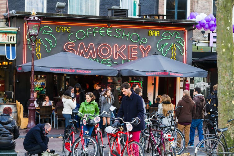 People outside a cannabis cafe