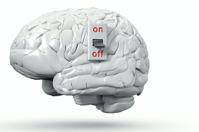 A drawing of a brain with a switch.