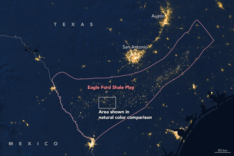 A satellite view of Texas at night shows gas flaring in the Eagle Ford shale region.