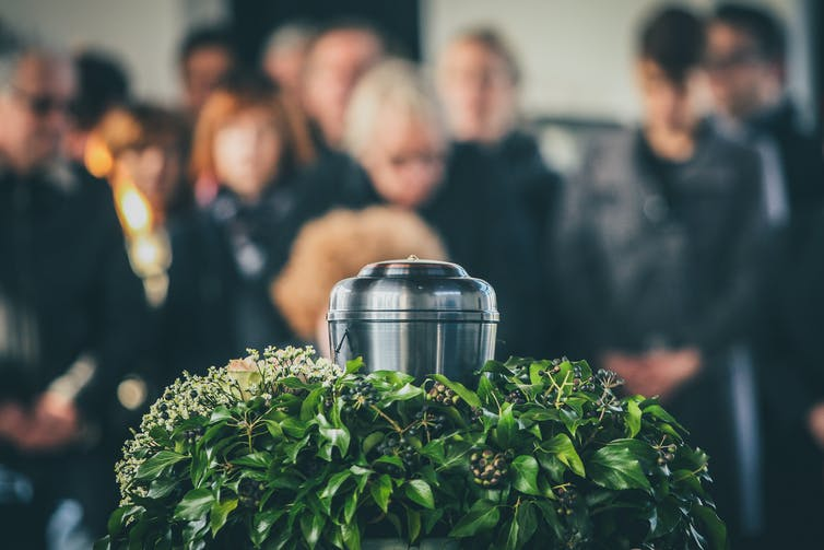 An urn with ashes at a funeral service.