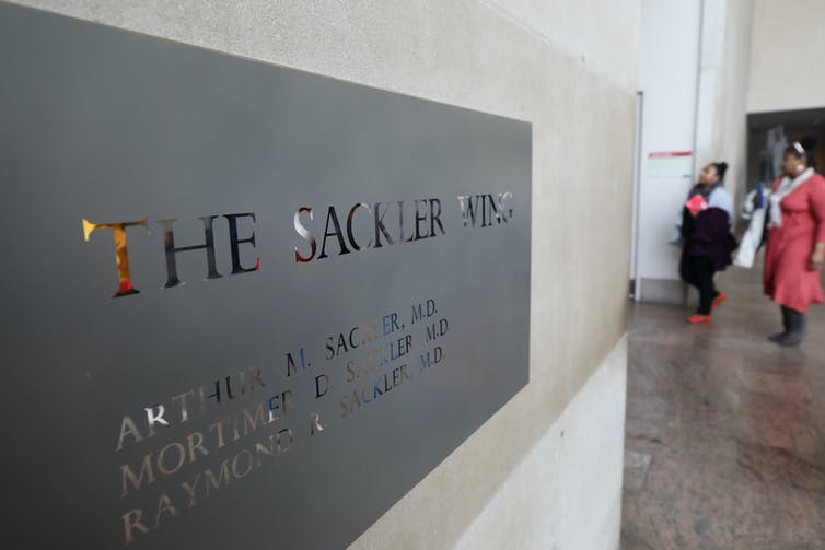 A sign hanging in the Metropolitan Museum of Art's Sackler Wing names all three brothers, Arthur, Mortimer and Raymond.